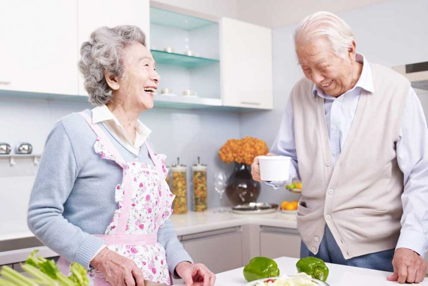 Burial Insurance couple in the kitchen laughing