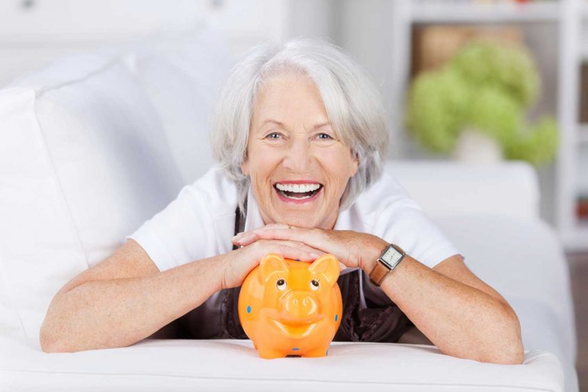 Burial Life Insurance For Seniors women with pumpkin smiling