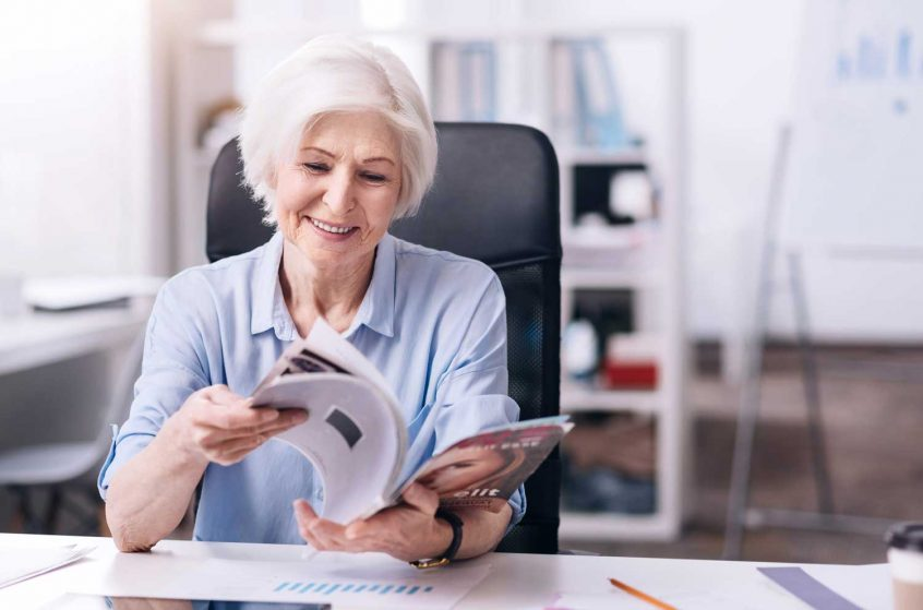 burial insurance after a heart attack senior woman reading magazine