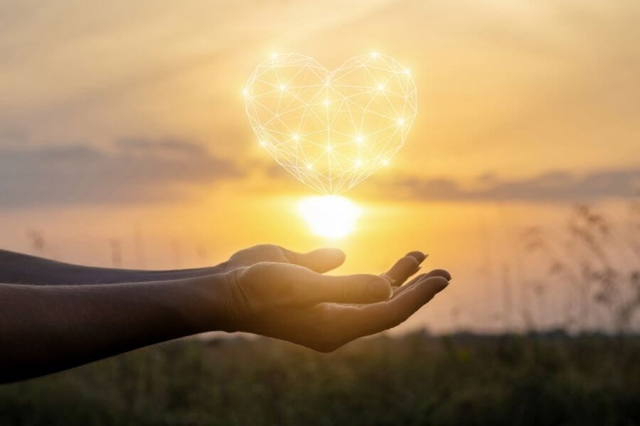 Heart and sun in hands
