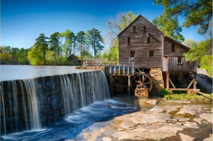 barn on a waterfall with blue sky