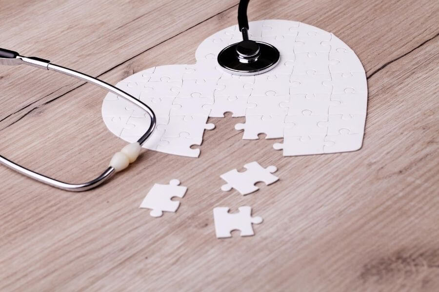 puzzle sitting on a table with stethoscope