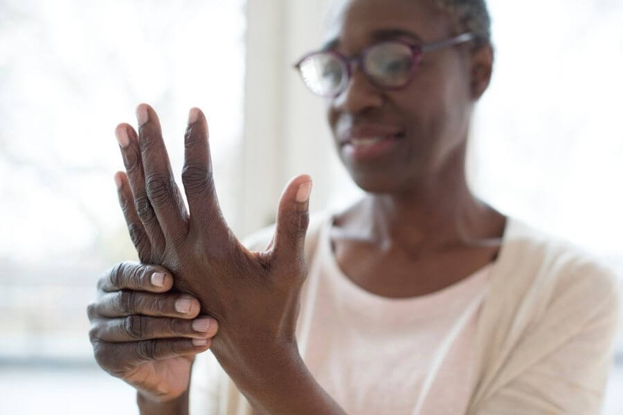 woman with arthritis pain in hand