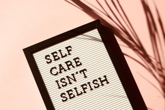 self care isn't selfish written on board