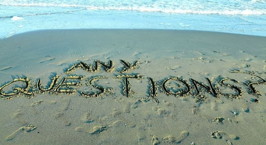 any questions written on sandy beach