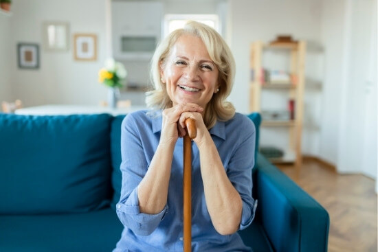woman with cane smiling