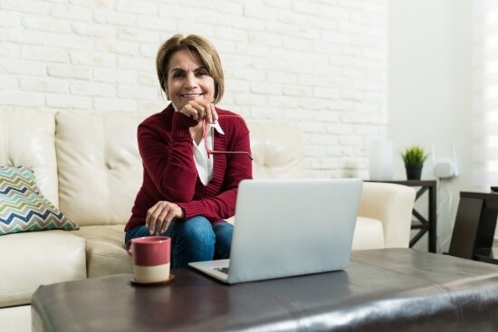 woman smiling on computer