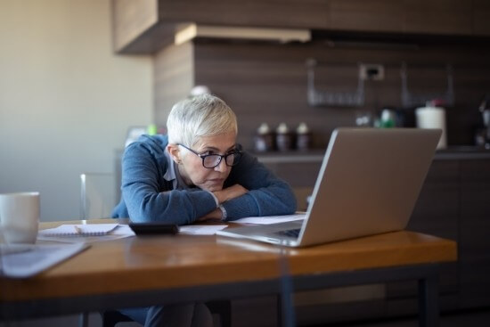 woman on computer thinking
