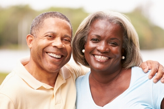 Man and woman smiling and standing